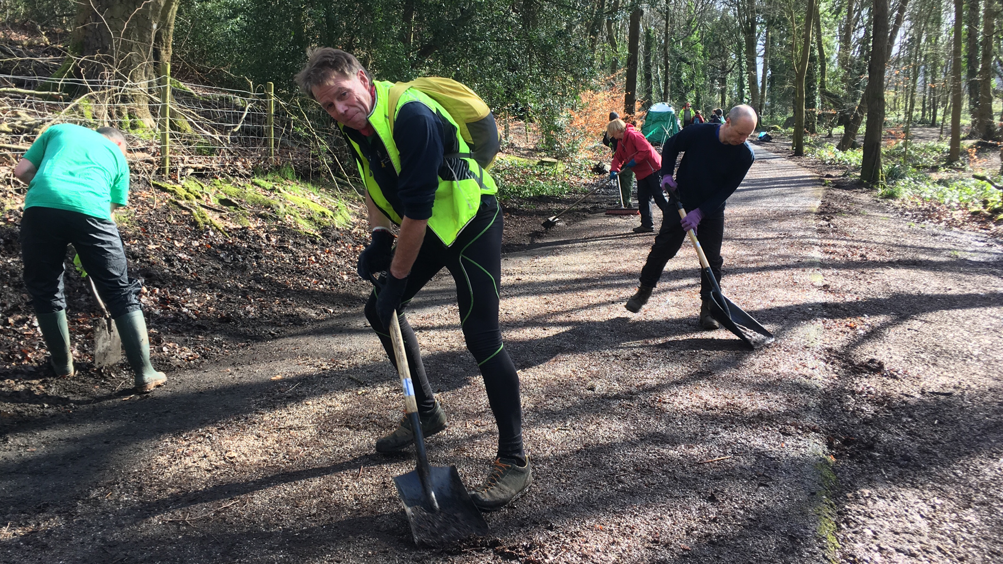 Volunteers clearing fallen leaves from the Upper Don Trail